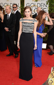 Allison Williams went the edgy route in a monochrome Alexander McQueen cutout dress during the Golden Globes.