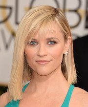 Reese Witherspoon debuted a trendy asymmetrical hairstyle on the Golden Globes red carpet.