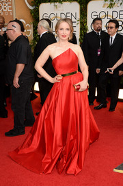 Julie Delpy went for modern glamour at the Golden Globes in a red Romona Keveza strapless gown with a geometric neckline.
