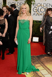 Taylor Shilling brought a jolt of color to the Golden Globes red carpet in a lingerie-inspired green gown by Thakoon.
