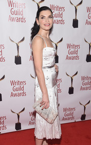Julianna Margulies paired a metallic clutch with a beaded cocktail dress for the 2019 Writers Guild Awards.