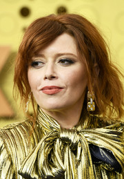 Natasha Lyonne went for a messy updo at the 2019 Emmy Awards.