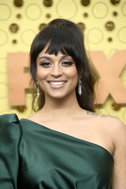 Lilly Singh attended the 2019 Emmy Awards wearing her hair in a ponytail with choppy bangs.