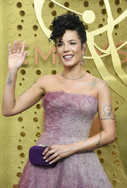 Halsey paired a purple suede clutch with a strapless lilac dress for the 2019 Emmy Awards.