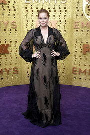 Amy Adams looked simply elegant in a sheer, embroidered black gown with a nude underlay at the 2019 Emmy Awards.