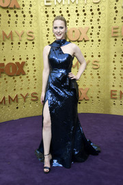 Rachel Brosnahan went for modern glamour in an asymmetrical navy sequined gown by Elie Saab Couture at the 2019 Emmy Awards.
