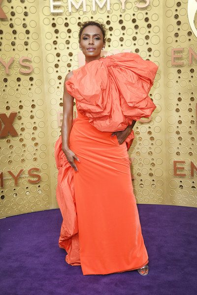 Janet Mock was impossible to miss in her bowed orange Valentino Couture gown at the 2019 Emmy Awards.