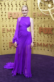Julia Garner went for an eye-popping purple cutout gown by Cong Tri at the 2019 Emmy Awards.
