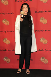 Marina Abramovic attended the George Foster Peabody Awards wearing a simple loose blouse, slacks, and coat combo.