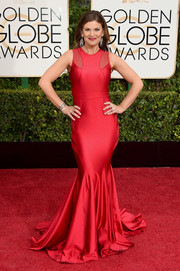 Kristin Dos Santos smoldered at the Golden Globes in a red Walter Mendez gown with a floor-sweeping mermaid hem.