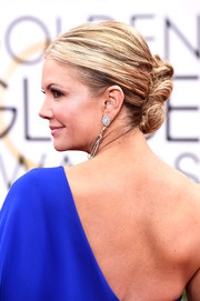 Nancy O'Dell was all dolled up with this messy-glam French twist at the Golden Globes.