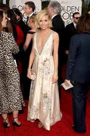 Sienna Miller was seductive yet classy at the Golden Globes in an ivory Miu Miu dress with a down-to-the-navel neckline and whimsical floral beading.