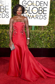 Viola Davis looked absolutely regal at the Golden Globes in a red Donna Karan Atelier strapless gown featuring an embellished bodice and a flowing train.