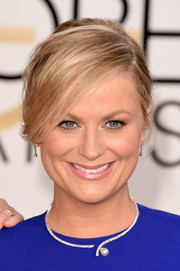 Amy Poehler opted for a laid-back bun with side-swept bangs when she attended the Golden Globes.