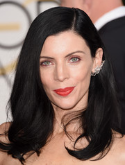 Liberty Ross wore her lush locks down with a side part and wavy ends during the Golden Globes.