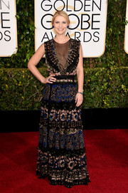 Claire Danes sported an exotic burst of feathers and beads with this Valentino number at the Golden Globes.