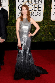 Julianne Moore exuded edgy glamour in her ombre Givenchy Couture sequined and feathered gown at the Golden Globes.
