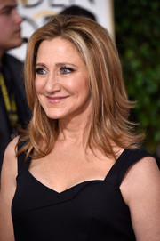 Edie Falco styled her hair with feathery layers for the Golden Globes.
