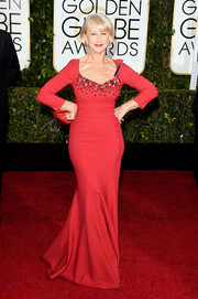 Helen Mirren flaunted her agelessly sexy figure in a curvy red Dolce & Gabbana gown, featuring a bejeweled neckline, during the Golden Globes.