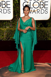 Jada Pinkett Smith was a Grecian goddess in green on the Golden Globes red carpet in this draped gown by Versace.
