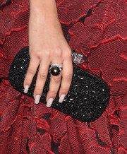 Zendaya Coleman sparkled with a black beaded purse at the 2016 Golden Globes Awards.