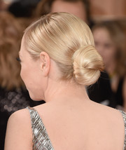 Portia Doubleday sported a sleek twisted bun at the Golden Globes.
