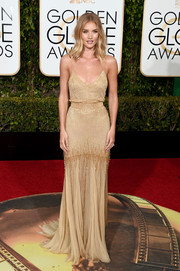 Rosie Huntington-Whiteley looked ravishing in a beaded gold slip dress by Atelier Versace at the Golden Globes.