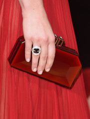 Natalie Dormer matched red with red when she carried her crimson hard case clutch with her to the 2016 Golden Globes Awards.