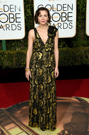 Maggie Gyllenhaal went for vintage glamour in a floral-beaded gown by Marc Jacobs at the Golden Globes.