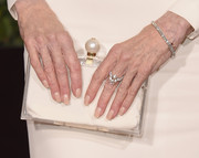 Jane Fonda matched her cream gown with a hard case clutch with pearl details at the 2016 Golden Globes Awards.
