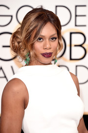 Laverne Cox paired her elegant white gown with a pop of dark maroon lipstick.