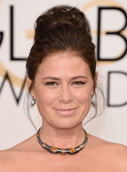 Maura Tierney swept her hair up into a curly bun for the Golden Globes.