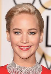 Golden Globe winner Jennifer Lawrence matched her lips to her red Dior gown.