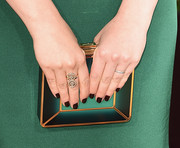 Rachel Bloom matched the emerald color of her gown to the bright green hue of her box clutch at the 2016 Golden Globes Awards.