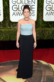 Maura Tierney opted for a simple two-tone strapless gown by Elizabeth Kennedy when she attended the Golden Globes.