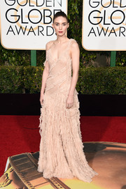 Rooney Mara chose a nude ruffle gown by Alexander McQueen for her Golden Globes red carpet look.