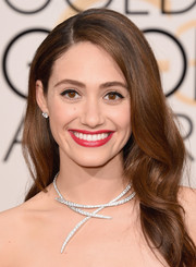 Emmy Rossum wore her tresses down with soft waves during the Golden Globes.