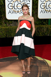 Olivia Palermo chose a fun and vibrant tricolor strapless dress by Delpozo for her Golden Globes look.