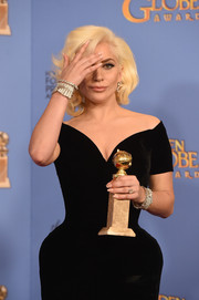 Lady Gaga accessorized her black gown with some statement bracelets by Neil Lane for the Golden Globes.