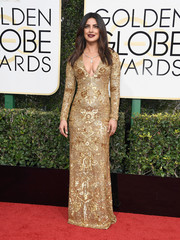 Priyanka Chopra was an elegant standout in a plunging, curve-hugging beaded gown by Ralph Lauren at the Golden Globes.
