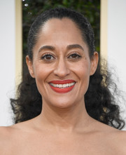 Tracee Ellis Ross attended the Golden Globes wearing her hair in a ponytail that was sleek at the front and curly at the back.