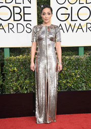 Ruth Negga went for standout shine in a silver zip-front sequin gown by Louis Vuitton at the Golden Globes.