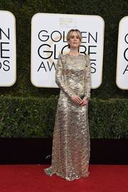 Sarah Paulson glimmered in a long-sleeve sequin gown by Marc Jacobs at the Golden Globes.