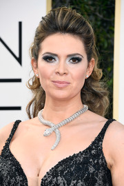 Carly Steel styled her hair into a curly ponytail with a teased top for the Golden Globes.