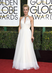 Gillian Anderson looked heavenly at the Golden Globes in a white Jenny Packham halter gown with a bejeweled neckline and  Sophie Hulme clutch.