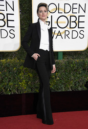 Evan Rachel Wood went for mannish elegance in a black tuxedo by Altuzarra at the Golden Globes.