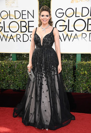 Carly Steel went ultra glam in a plunging, embellished Jovani Signature gown, in black with a white underlay, for the Golden Globes.
