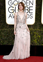 Emma Stone looked enchanting at the Golden Globes in a pale-pink Valentino gown embellished with sequin stars.