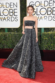 Jeannie Mai was all about modern glamour at the Golden Globes in a textured gunmetal-gray strapless gown with a peekaboo midriff.