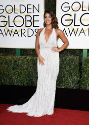 Gina Rodriguez worked a '20s-glam vibe in a fringed and beaded halter gown by Naeem Khan at the Golden Globes.